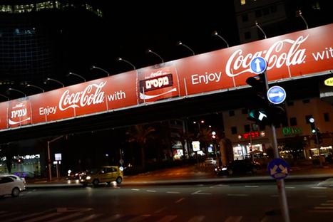 Une application iPhone de Coca-Cola qui personnalise les panneaux publicitaires à votre approche !   Communication   Scoop.it