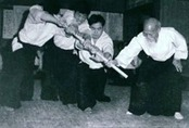 """Aiki Ken and Jo Suburi: Part 16 – Hasso Gaeshi Ushiro Tsuki"" by James Neiman 