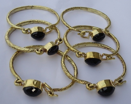 fair trade Cambodia. Jewellery made from recycled brass bomb shell hammered natural black stone cuffs, ethically handcrafted by disadvantaged home based workers.   Silk Scarfs, Ethically handmade   Scoop.it