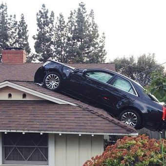 """XXXTreme's """"Things that Make you Go hmm!! Man's car lands on neighbor's roof in strange accident 