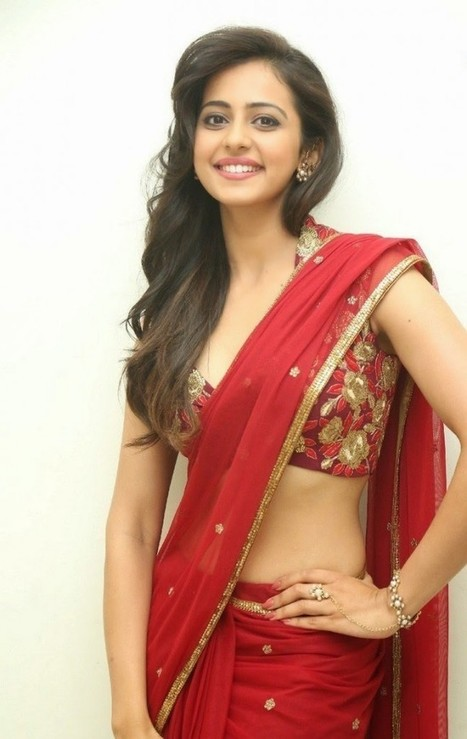 Rakul Preet Singh Pictures in Red Bridal Saree showing Navel at Tiger Audio Release IndianRamp.com, Actress, Bollywood, Indian Fashion, Tollywood | Indian Fashion Updates | Scoop.it