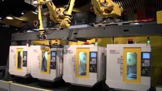 Two Overhead Rail Mounted Robots Tend Four Others Fanuc