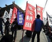 Rebel China village re-elects protest leader in sombre vote   Sustain Our Earth   Scoop.it