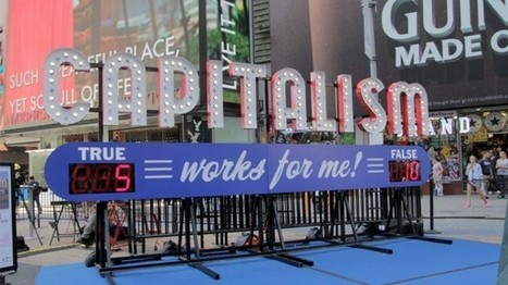 """Capitalism Works for Me!"" Interactive Sign Turns on in Times Square 