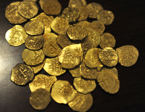 Photo: ERIC HASERT/TREASURE COAST NEWSPAPERS Gold doubloons from the 1715 Spanish Fleet rest on a table after being recovered off shore from Wabasso by the 1715 Fleet-Queens Jewels LLC. Of Sebastia... | Anthropology, Archaeology, and History | Scoop.it