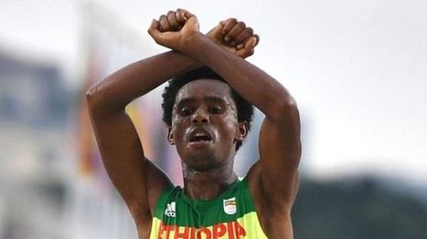 Ethiopian runner makes protest sign as he crosses line in Rio   Sport, Education & the Media.   Scoop.it