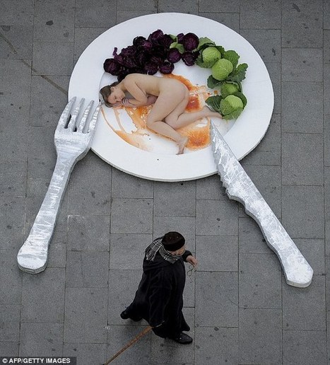 What a dish: Protester lies naked on giant plate in the street to highlight animal cruelty | Factory Farms | Scoop.it