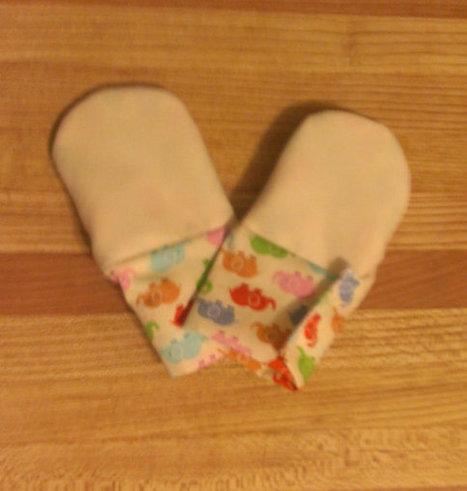 Cream Waterproof Teething Mittens for Finger Chewing Babies * velcro cuff*   Teething Baby? --> Waterproof Teething Mittens   Scoop.it
