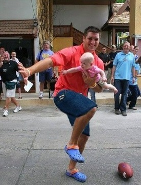 Just a picture of Tim Tebow striking the Heisman pose with a baby as a football - Front Page Buzz | ESPNTMZ | Scoop.it