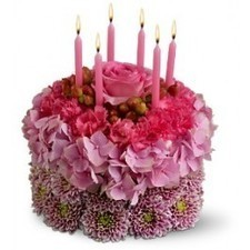 """Is it someone's birthday today? Tell them to blow out all the candles on this fabulous pink """"cake,"""" and all of their wishes will come true! Our adorable cake is created entirely from fresh flowers ... 