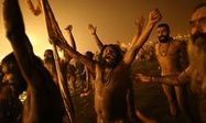 Indian holy men celebrate in the waters at Sangram - picture of the day   Southmoore AP Human Geography   Scoop.it