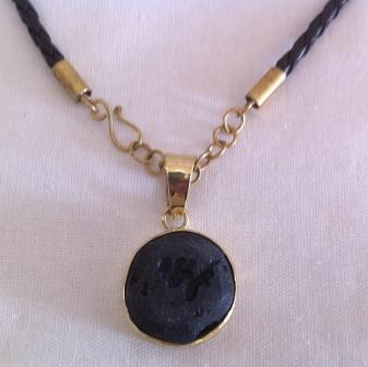 fair trade Cambodia.Recycled bomb shell natural Nil Black stone pendant, ethically handmade by disadvantaged home based artisans.   Recycled Bomb Casings & Bullet Shell Jewellery   Scoop.it