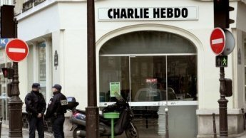 French Muslim groups sue magazine over cartoons - FRANCE 24 | The Indigenous Uprising of the British Isles | Scoop.it