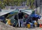 Fire fuels fear as homeless rebuild camp - San Francisco Chronicle | Homeless Shelter Makeovers | Scoop.it