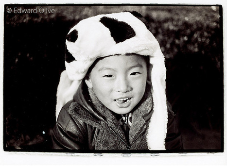 Boy in furry hat in Shanghai © Edward Olive street portrait photographer | Photographers in Madrid Barcelona Spain | Scoop.it