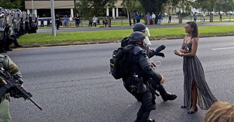 Photo of police in riot gear arresting protester in a dress strikes chord on social media | Black Education | Scoop.it