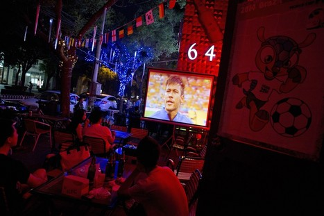 China calls in sick, burns midnight oil to watch World Cup - Los Angeles Times | Fifa World Cup 2014 | Scoop.it