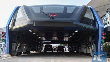 China finally built an elevated bus that straddles traffic and it's totally bizarre | Strange days indeed... | Scoop.it