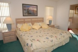 """Master bedroom with king size bed 6'8"""" x 6'6"""", TV, patio doors leading onto pool area and master bathroom   Our Florida House   Scoop.it"""