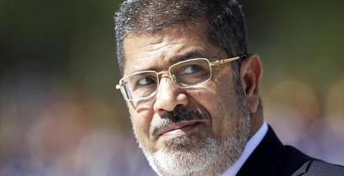 Ousted Egyptian president Mursi arrives at trial site as a War Criminal, may Expose obama as a collaborator