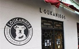 """Loukanikos"" Bar Opens in Madrid After Famous Greek Riot-Dog 