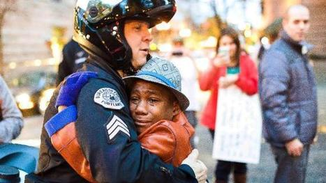 Encounter at protest leads to hug for boy, officer | Photography | Scoop.it