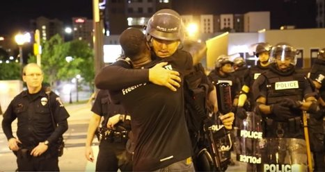 A protester in Charlotte gave out free hugs to police in riot gear -  and they were incredibly grateful | Daily News Reads | Scoop.it