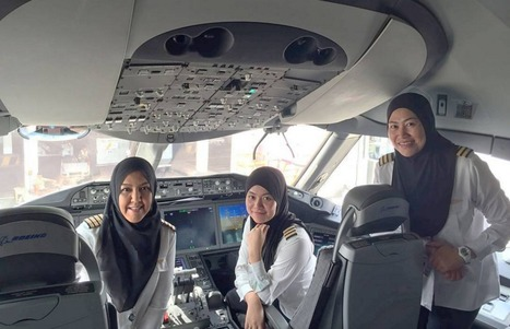"Who are the three Royal Brunei pilots who made the first ""unmanned"" flight to Saudi Arabia? 