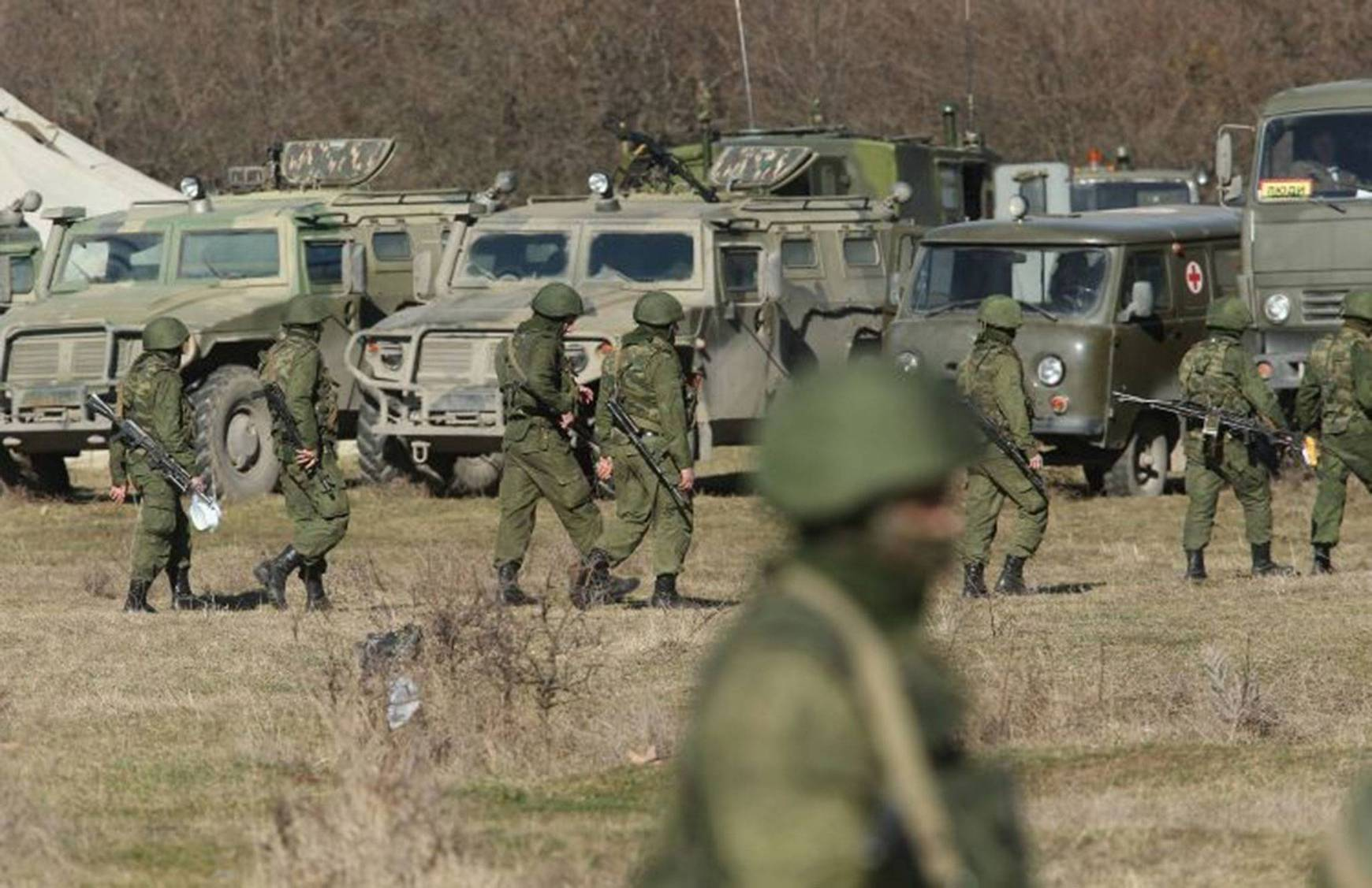 Ukraine latest: Armed men seize defence post in the Crimean city of Sevastopol