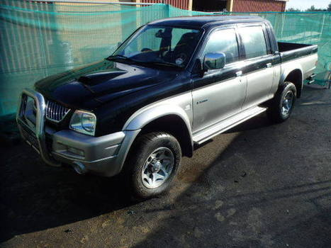 Salvage 2005 black Mitsubishi L200 2.5Td with VIN MMBJNK7405D on auction   cars   Scoop.it