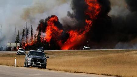 Canada fires another sign global warming is here, scientists say | Climate change challenges | Scoop.it