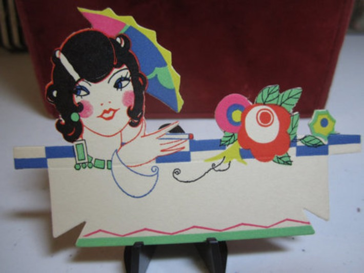 Colorful art deco Gibson 1920's die cut place card bobbed vamp with large hair comb deco jewelry cigarette in hand | Antiques & Vintage Collectibles | Scoop.it