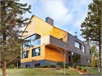 Une résidence inspirée d'une grange traditionnelle prend racine au Québec | Architecture et construction bois | Scoop.it