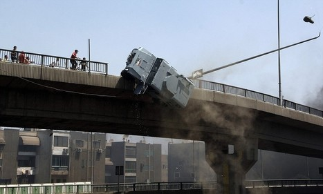 Horrifying moment Egyptian protestors pushed an armoured police van 50ft off a bridge before officers were stoned by mob | Egyptian Protests 2013 | Scoop.it