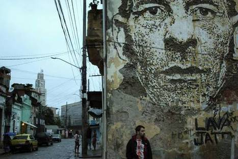 Vhils with one of his artworks | World of Street & Outdoor Arts | Scoop.it