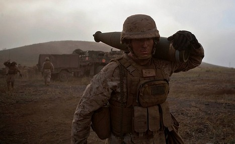 U.S. Marine Lance Cpl. Michael Farris, carries a round back to his gun to resupply before a fire mission aboard Pohakuloa Training Area, Hawaii. | Military-Stuff | Scoop.it
