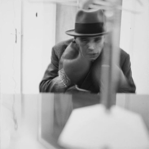 "Joseph Beuys performing his piece ""Felt TV"" (photo by Lothar Wolleh, via Wikipedia)"