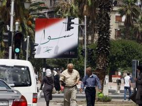 Cartazes de Bashar Al-Assad marcam início de campanha eleitoral - RFI | Guerra na Síria | Scoop.it
