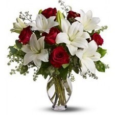 The fragrant bouquet includes white Asiatic lilies and red roses accented with fresh greenery delivered in a classic clear glass vase. | Floral Happiness | Scoop.it