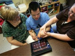 Adapting to the iPad, called education's 'equalizer' | Young children with special needs | Scoop.it