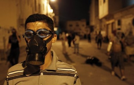 Anti-govt protester wears a tear gas mask during a demonstration in Karrana | Human Rights and the Will to be free | Scoop.it