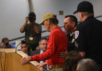 Protesters quietly take a stand at meeting   Criminal Justice in America   Scoop.it