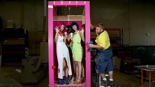 Women inside of a vending machine