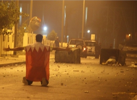 Brave youth armed with only a flag of Bahrain, in BaniJamra | Human Rights and the Will to be free | Scoop.it