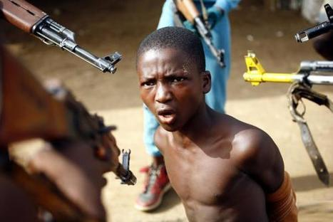 NO WORLD ORDER, A young man is held at gunpoint by child soldiers...   Child Soldiers in the world   Scoop.it