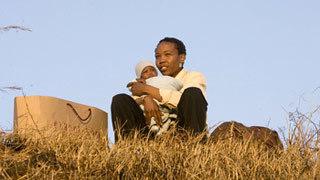 Tsotsi holding the kidnapped baby   Tsotsi   Scoop.it