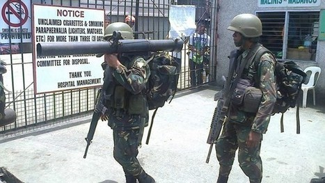 "Philippine rebels use ""human shields"" in stand-off with troops 