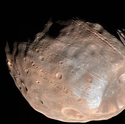 Gravity will rip Martian moon apart to form dust and rubble ring   694028   Scoop.it