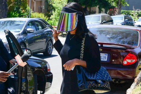 """Donald Sterling's Former Mistress Makes the """"Paparazzi Shield"""" Chic; Cara Delevingne Has Self-Grooming Eyebrows 