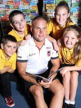 Rugby league players recruited to help thousands of kids to read - Herald Sun | Informed Teacher Librarianship | Scoop.it